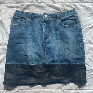 Denim skirt with faux leather hem